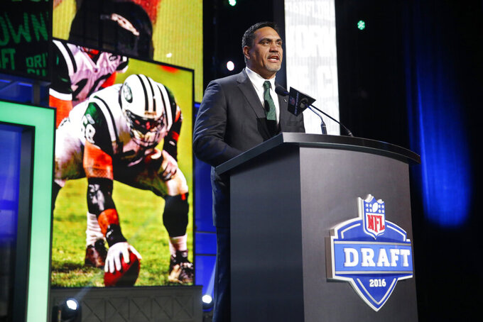 FILE - In this April 29, 2016, file photo, Kevin Mawae announces that the New York Jets select Georgia's Jordan Jenkins as the 83rd pick in the third round of the 2016 NFL football draft, in Chicago. Mawae will be inducted into the Pro Football Hall of Fame in Canton, Ohio on Aug. 3, 2019.(AP Photo/Charles Rex Arbogast, File)