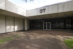 This Monday, Sept. 16, 2019 photo, shows the entrance to Building 37, also called the Lunar Receiving Laboratory at Johnson Space Center in Houston, where astronauts and lunar rocks were quarantined after they arrived. The building has not been used for two years, and is slated for demolition. (Jon Shapley/Houston Chronicle via AP)