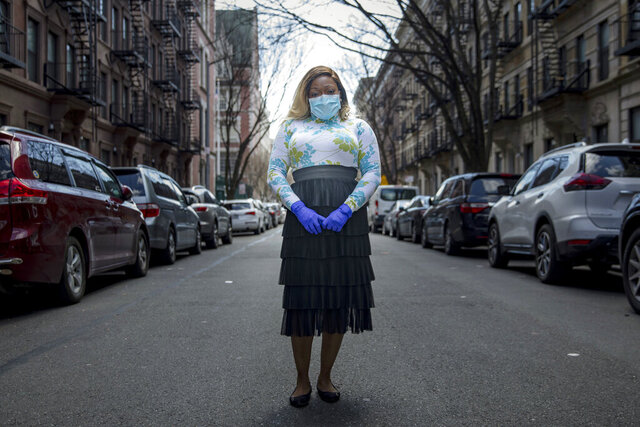 Tiffany Pinckney poses for a portrait in the Harlem neighborhood of New York on April 1, 2020. After a period of quarantine at home separated from her children, she has recovered from COVID-19. Pinckney became one of the nations first donors of