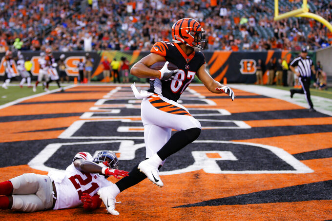 Cincinnati Bengals tight end C.J. Uzomah (87) scores a touchdown against New York Giants safety Jabrill Peppers (21) during the first half of an NFL preseason football game Thursday, Aug. 22, 2019, in Cincinnati. (AP Photo/Gary Landers)