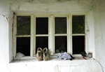 Migrants personal items left on a window in an abandoned house in the village of Majdan, Serbia, Thursday, July 22, 2021. Empty or abandoned houses serve as temporary homes to people who fled their own homes in the Middle East, Africa or Asia with an aim to start a new life somewhere else. (AP Photo/Darko Vojinovic)