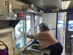 Yolanda Parson is pictured inside of her food truck, Crab Cravers, at its grand opening in Wilmington, Delaware, on Sunday, July 18, 2021. (José Ignacio Castañeda /The News Journal via AP)