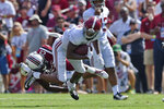 Alabama's DeVonta Smith, top, rushes while defended by South Carolina's J.T. Ibe during the first half of an NCAA college football game Saturday, Sept. 14, 2019, in Columbia, S.C. (AP Photo/Richard Shiro)