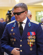 In this photo taken on Thursday, Feb. 14, 2019, Vladimir Vshivtsev, a veteran of the Soviet war in Afghanistan attends a meeting at the upper chamber of Russian parliament in Moscow, Russia. Vshivtsev, who was wounded in action and lost his eye-sight, became a leading activist in the Russian Society for the Blind and served a stint in the Russian parliament. (AP Photo/Alexander Zemlianichenko)