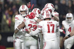 Wisconsin running back Jonathan Taylor (23) celebrates his game-winning touchdown against Purdue during overtime of an NCAA college football game in West Lafayette, Ind., Saturday, Nov. 17, 2018. Wisconsin defeated Purdue 47-44 in overtime. (AP Photo/Michael Conroy)
