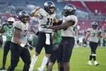 Central Florida quarterback Dillon Gabriel (11) celebrates after a touchdown against Marshall during the Gasparilla Bowl NCAA college football game Monday, Dec. 23, 2019, in Tampa, Fla. (Stephen M. Dowell/Orlando Sentinel via AP)