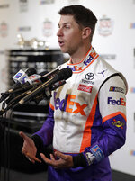 Denny Hamlin answers questions during NASCAR Daytona 500 auto racing media day at Daytona International Speedway, Wednesday, Feb. 13, 2019, in Daytona Beach, Fla. (AP Photo/John Raoux)