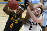 Baylor forward Flo Thamba (0) fights for a rebound with Gonzaga forward Drew Timme (2) during the first half of the championship game in the men's Final Four NCAA college basketball tournament, Monday, April 5, 2021, at Lucas Oil Stadium in Indianapolis. (AP Photo/Michael Conroy)
