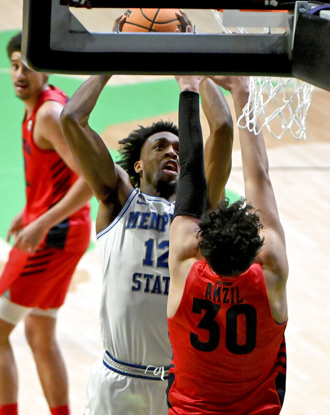 Memphis forward DeAndre Williams (12) shoots over Dayton forward Mustapha Amzil (30) in the second half of an NCAA college basketball game in the first round of the NIT Tournament, Saturday, March 20, 2021, in Denton, Texas. Memphis won 71-60. (AP Photo/Matt Strasen)