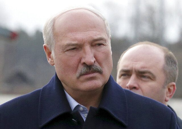 Belarusian President Alexander Lukashenko speaks to journalists as he visits the Dobrush Paper Factory in Dobrush, Belarus, Tuesday, Feb. 4, 2020.  The leader of Belarus is boasting about better ties with the United States as his officials discuss alternative energy imports as part of efforts to win concessions from Russia. (Nikolai Petrov/BelTA Pool Photo via AP)