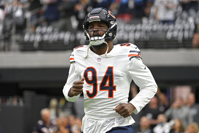 FILE - In this Oct. 10, 2021, file photo, Chicago Bears outside linebacker Robert Quinn warms up for the team's NFL football game against the Las Vegas Raiders in Las Vegas. The Bears placed Quinn on the reserve/COVID-19 list Tuesday, Oct. 19, possibly leaving them without one of their top pass rushers when they visit Tom Brady and the defending Super Bowl champion Tampa Bay Buccaneers. (AP Photo/David Becker, File)