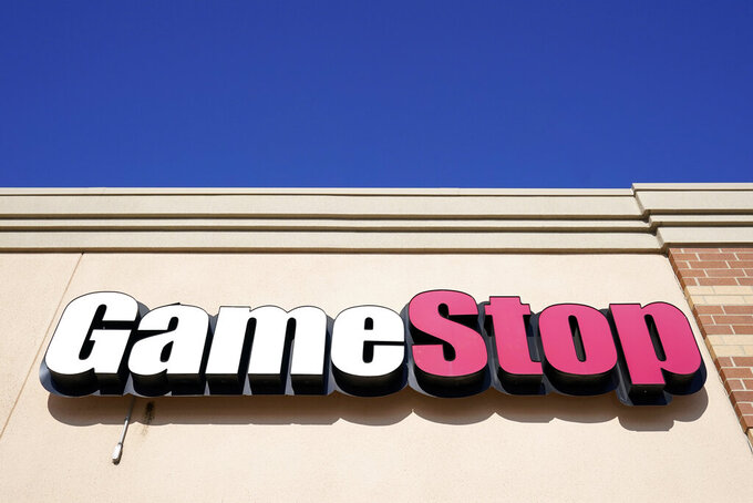 FILE - In this Jan. 28, 2021, file photo, aGameStop sign is displayed above a store in Urbandale, Iowa. GameStop and other meme stocks are soaring again. Much of professional Wall Street said earlier in the year that the phenomenon would likely fizzle out in time, particularly after the smaller-pocketed and novice investors behind it felt the pain of losing their money. But GameStop has recovered most of its plunge from its January peak. (AP Photo/Charlie Neibergall, File)