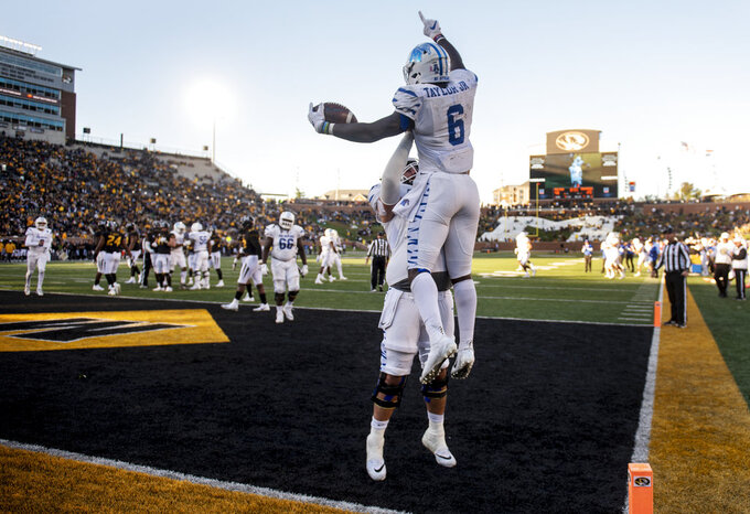 Memphis running back Patrick Taylor Jr., top, celebrates his touchdown with Drew Kyser during the second half of an NCAA college football game against Missouri, Saturday, Oct. 20, 2018, in Columbia, Mo. Missouri won the game 65-33. (AP Photo/L.G. Patterson)