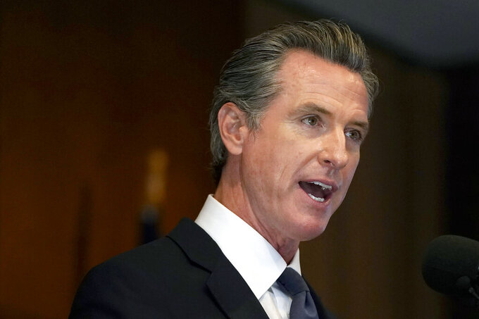 """FILE - In this Sept. 14, 2021, file photo, Gov. Gavin Newsom speaks in San Francisco. Gov. Newsom signed two laws on Wednesday, Sept. 22, 2021, that aim to protect the privacy of abortion providers and their patients, declaring California to be a """"reproductive freedom state"""" in contrast to Texas and its efforts to limit the procedure. (AP Photo/Jeff Chiu, File)"""
