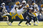 Green Bay Packers outside linebacker Preston Smith sacks Los Angeles Chargers quarterback Philip Rivers during the first half of an NFL football game Sunday, Nov. 3, 2019, in Carson, Calif. (AP Photo/Marcio Jose Sanchez)