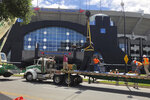 "A statue of former Carolina Panthers owner Jerry Richardson is lowered onto a truck after it was removed from in front of the team's stadium in Charlotte, N.C., Wednesday, June 10, 2020. ""We were aware of the most recent conversation surrounding the Jerry Richardson statue and are concerned there may be attempts to take it down,"" the team said in a statement. ""We are moving the statue in the interest of public safety."" (AP Photo/Steve Reed)"