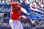 Toronto Blue Jays' Vladimir Guerrero Jr. hits a double during the first inning of a baseball game against the Kansas City Roysla  in Toronto, Monday, July 1, 2019. (Jon Blacker/The Canadian Press via AP)