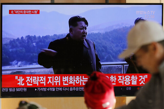 """People watch a TV news program reporting North Korea's announcement with a file footage of North Korean leader Kim Jong Un, at the Seoul Railway Station in Seoul, South Korea, Sunday, Dec. 8, 2019. North Korea said Sunday it carried out a """"very important test"""" at its long-range rocket launch site that U.S. and South Korean officials said the North had partially dismantled as part of denuclearization steps. The letters, top left, read"""
