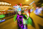 The Mystic Krewe of Nyx parade makes its way through the streets of New Orleans, Wednesday, Feb. 19, 2020. (AP Photo/Brett Duke)