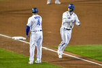 Toronto Blue Jays' Randal Grichuk, right, celebrates with third base coach Luis Rivera, left, after hitting a solo home run against the New York Yankees during the sixth inning of a baseball game in Buffalo, N.Y., Monday, Sept. 21, 2020. (AP Photo/Adrian Kraus)