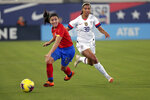 Costa Rica's Lixy Rodriguez, left, moves the ball away from U.S. forward Margaret Purce (30) during the first half of an international friendly soccer match Sunday, Nov. 10, 2019, in Jacksonville, Fla. (AP Photo/John Raoux)