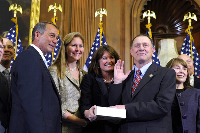 FILE - In this Jan. 5, 2011, file photo, House Speaker John Boehner, left, of Ohio reenacts the swearing in of Rep. Richard Hanna, R-N.Y., on Capitol Hill in Washington. Hanna, a moderate Republican from upstate New York who broke with his party in 2016 over supporting then-candidate Donald Trump, died Sunday, March 15, 2020, after a battle with cancer, his family said. He was 69. (AP Photo/Susan Walsh, File)