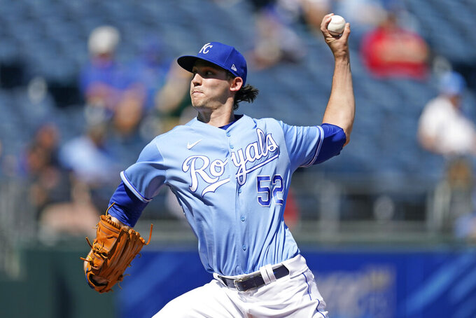 Kansas City Royals starting pitcher Daniel Lynch throws during the first inning of a baseball game against the Oakland Athletics Thursday, Sept. 16, 2021, in Kansas City, Mo. (AP Photo/Charlie Riedel)