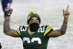 Green Bay Packers' Jaire Alexander celebrates after an NFL football game against the Tennessee Titans Sunday, Dec. 27, 2020, in Green Bay, Wis. The Packers won 40-14. (AP Photo/Mike Roemer)