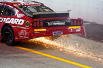 John Hunter (38) sparks up during a NASCAR Cup Series auto race Sunday, Sept. 6, 2020, in Darlington, S.C. (AP Photo/Chris Carlson)