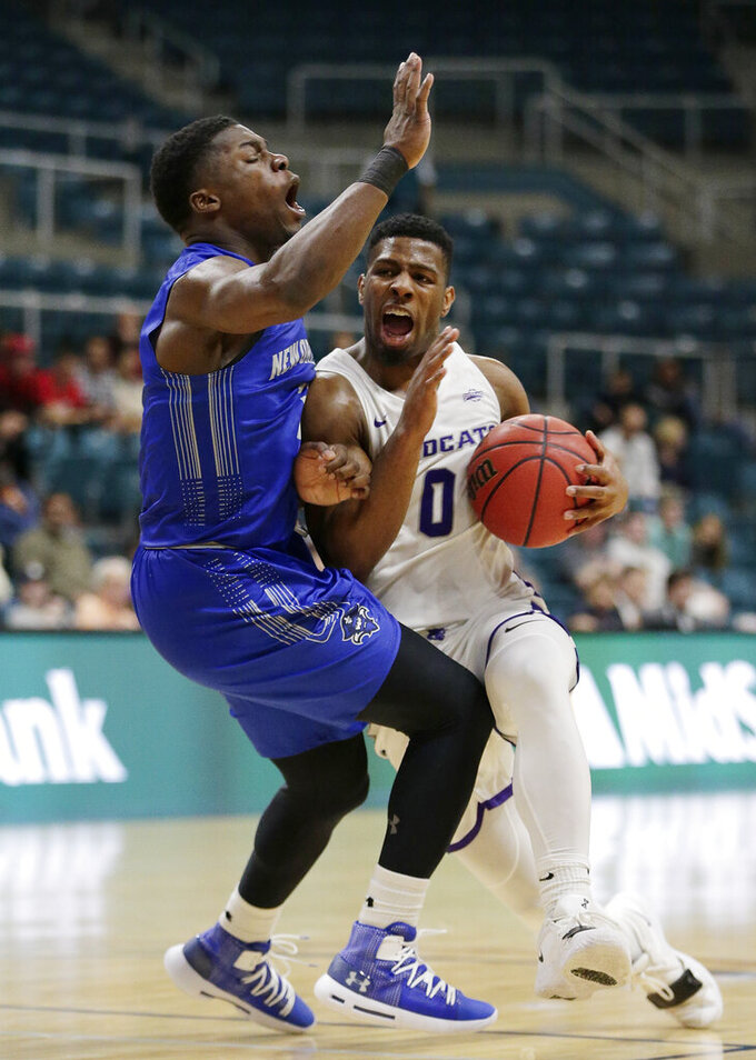 Abilene Christian guard Jaylen Franklin (0) drives into New Orleans guard Troy Green during the second half of an NCAA college basketball game for the Southland Conference men's tournament title Saturday, March 16, 2019, in Katy, Texas. (AP Photo/Michael Wyke)