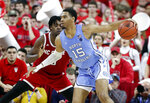 North Carolina's Garrison Brooks (15) maneuvers around North Carolina State's D.J. Funderburk (0) during the second half of an NCAA college basketball game at PNC Arena in Raleigh, N.C., Monday, Jan. 27, 2020. (Ethan Hyman/The News & Observer via AP)