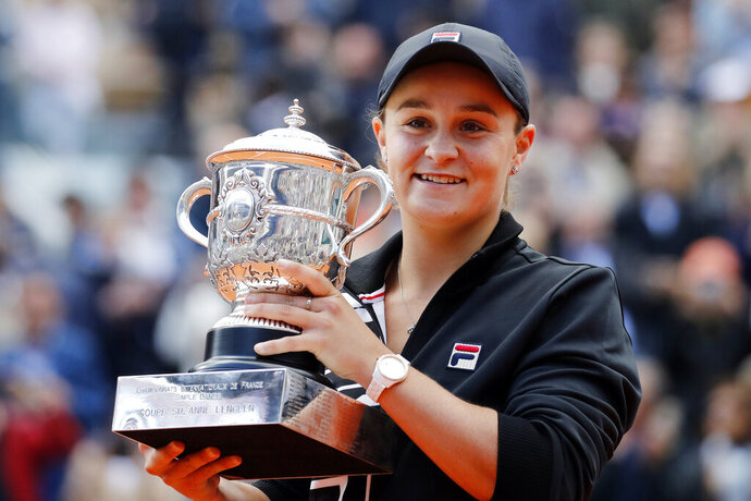 FILE - In this June 8, 2019, file photo, Australia's Ashleigh Barty holds the trophy as she celebrates after defeating Marketa Vondrousova, of the Czech Republic, in the women's final of the French Open tennis tournament at the Roland Garros stadium in Paris. Barty is ready to cap off the most successful season of her career with a first appearance in the year-end WTA Finals. (AP Photo/Christophe Ena, File)
