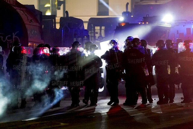 Authorities disperse protesters out of a park Tuesday, Aug. 25, 2020 in Kenosha, Wis. Anger over the Sunday shooting of Jacob Blake, a Black man, by police spilled into the streets for a third night. (AP Photo/Morry Gash)