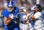 Air Force's Timothy Jackson, left, blocks Army freshman Jemel Jones (7) as he carries the ball downfield during an NCAA college football game in Air Force Academy, Colo., Saturday, Nov. 2, 2019. (Chancey Bush/The Gazette via AP)