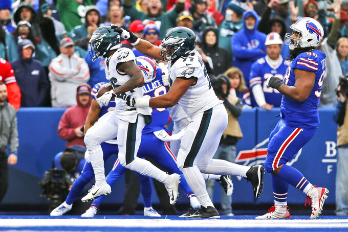 Philadelphia Eagles' Andre Dillard, center, celebrates with Miles Sanders, left, after Sanders scored a two-point conversion during the first half of an NFL football game against the Buffalo Bills, Sunday, Oct. 27, 2019, in Orchard Park, N.Y. (AP Photo/John Munson)