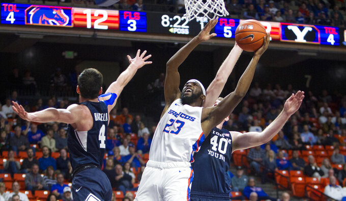 Boise State guard RJ Williams drives the lane and is fouled by BYUforward Kolby Lee in the first half  of an NCAA college basketball game Wednesday, Nov. 20, 2019, in Boise. (Darin Oswald/Idaho Statesman via AP)
