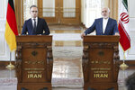 Iranian Foreign Minister Mohammad Javad Zarif, right, and his German counterpart Heiko Maas give a press conference after their talks, in Tehran, Iran, Monday, June 10, 2019. Zarif warned the U.S. on Monday that it