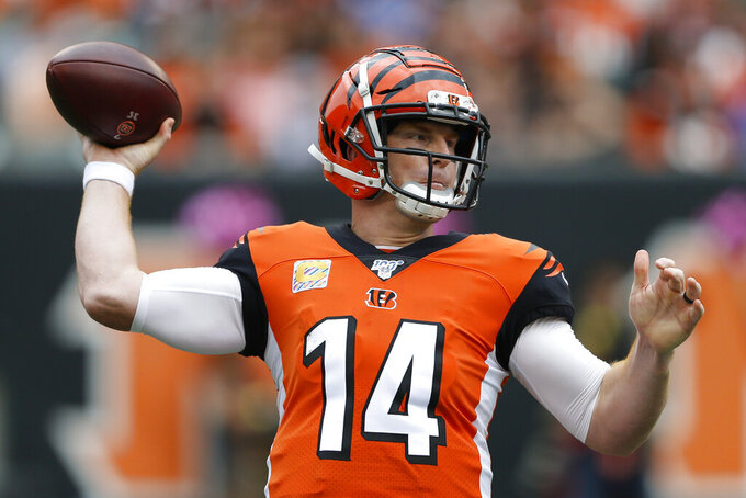 Cincinnati Bengals quarterback Andy Dalton passes in the first half of an NFL football game against the Arizona Cardinals, Sunday, Oct. 6, 2019, in Cincinnati. (AP Photo/Gary Landers)