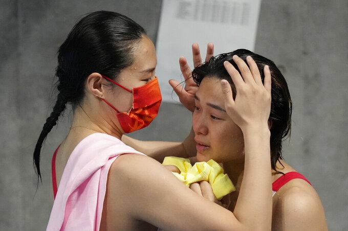 Shi Tingmao of China, right, gold medal and Wang Han of China, silver medal react after women's diving 3m springboard final at the Tokyo Aquatics Centre at the 2020 Summer Olympics, Sunday, Aug. 1, 2021, in Tokyo, Japan. (AP Photo/Dmitri Lovetsky)