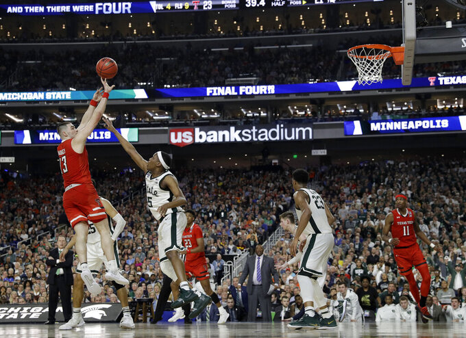 Texas Tech guard Matt Mooney, left, shoots over Michigan State guard Cassius Winston (5) during the first half in the semifinals of the Final Four NCAA college basketball tournament, Saturday, April 6, 2019, in Minneapolis. (AP Photo/Jeff Roberson)
