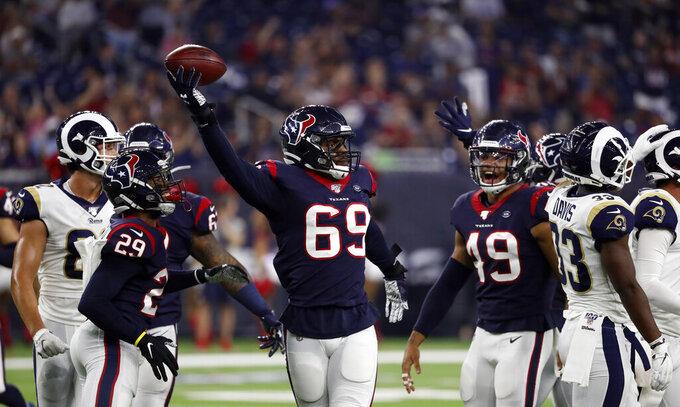 Houston Texans linebacker Jesse Aniebonam (69) celebrates after intercepting a pass against the Los Angeles Rams during the first half of a preseason NFL football game Thursday, Aug. 29, 2019, in Houston. (AP Photo/Kevin M. Cox)