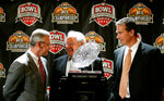 FILE - In this Jan. 7, 2007, file photo, Ohio State head coach Jim Tressel, left, and Florida head coach Urban Meyer, right, are joined by former Ohio State coach Earle Bruce, center, as they stand with the BCS college football championship trophy in Scottsdale, Ariz. Bruce died in Columbus, Ohio at the age of 87, according to a statement released by his daughters through Ohio State on Friday, April 20, 2018. He'd been suffering from Alzheimer's disease. (AP Photo/Ted S. Warren, File)