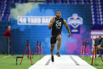 Ohio State defensive back Jeff Okudah runs the 40-yard dash at the NFL football scouting combine in Indianapolis, Sunday, March 1, 2020. (AP Photo/Michael Conroy)
