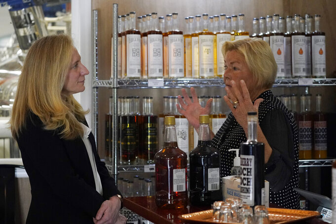 In this Monday, June 7, 2021, photo Rep Abigail Spanberger, D-Va., left, talks with distiller Sherry Brockenbrough, during a tour of the Hilltop distillery in Maidens, Va. Spanberger held a roundtable discussion with distillers to discuss COVID-19 reopening challenges experienced by small businesses & regulatory issues facing central Virginia distilleries. (AP Photo/Steve Helber)