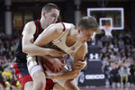 Louisville guard Ryan McMahon, left, fouls Boston College guard Julian Rishwain during the first half of an NCAA college basketball game in Boston, Wednesday, Jan. 29, 2020. (AP Photo/Charles Krupa)