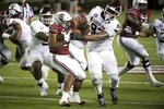 Texas A&M defensive lineman Jayden Peevy (92) tackles South Carolina running back Kevin Harris (20) during the first half of an NCAA college football game Saturday, Nov. 7, 2020, in Columbia, S.C. (AP Photo/Sean Rayford)