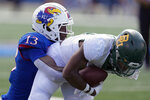 Baylor wide receiver Josh Fleeks, right, is tackled by Kansas cornerback Ra'Mello Dotson (13) during the first half of an NCAA college football game in Lawrence, Kan., Saturday, Sept. 18 2021. (AP Photo/Orlin Wagner)