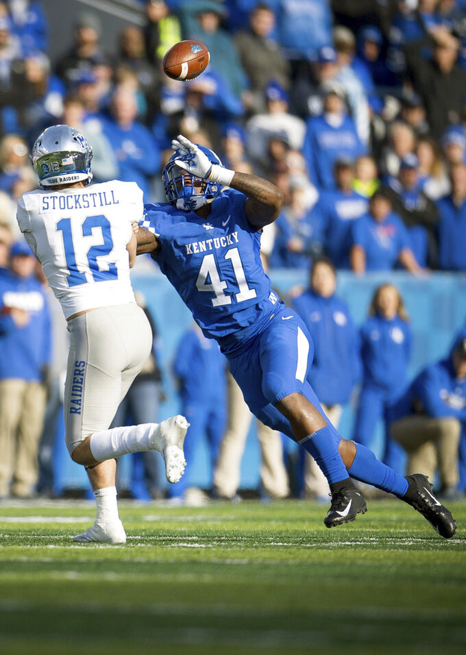 Kentucky linebacker Josh Allen (41) pressures Middle Tennessee quarterback Brent Stockstill (12) during the second half of an NCAA college football game against Kentucky in Lexington, Ky., Saturday, Nov. 17, 2018. (AP Photo/Bryan Woolston)