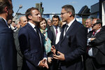 French President Emmanuel Macron talks with Eric Beranger, right, Chief Executive Officer of MBDA missile Systems, the 53rd International Paris Air Show at Le Bourget Airport near Paris, France, Monday June 17, 2019. The world's aviation elite are gathering at the Paris Air Show with safety concerns on many minds after two crashes of the popular Boeing 737 Max. (Benoit Tessier/Pool via AP)