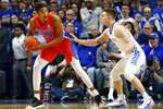 Florida's Kerry Blackshear Jr. (24) looks for an opening on Kentucky's Nick Richards in the first half of an NCAA college basketball game in Lexington, Ky., Saturday, Feb. 22, 2020. (AP Photo/James Crisp)